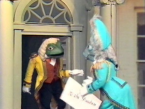"The Fish Footman delivers ""an invitation for the Duchess to play croquet"" to the Frog Footman."
