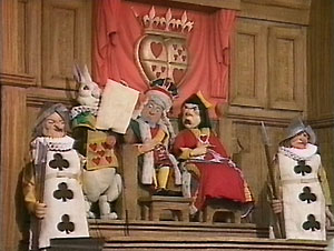 "In the Courtroom: the King and Queen of Hearts: ""Give your evidence,"" said the King."