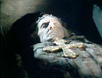 The corpse in the church crypt, with the second golden cross.
