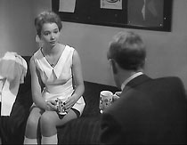 Frank (Alfred Burke) has tea with Dorry Milner (Pauline Challoner)