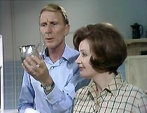Frank Marker (Alfred Burke) and Helen Mortimer (Pauline Delaney) do the washing up.