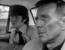 Frank (Alfred Burke) shares a police car with murder suspect Barry Osborne (Billy Hamon)