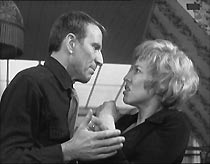Frank (Alfred Burke) remonstrates with Grace (Heather Canning), after she steals his money.