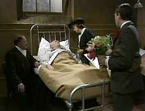 Mick Murphy (J.G.Devlin) is visited in hospital by neighbour Jimmy (Alan Hockey), Bella Seaton (Jean Heywood) and Ralph Murphy (John White).