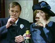 Mr and Mrs Jack Ford (James Bolam and Madelaine Newton) share a bottle of champagne.