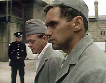 Jack (James Bolam) and Tom (John Nightingale) exercise in the prison yard.