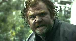 Frank (Brendan Gleeson) exhibits a moment of rage.