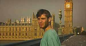 Jim (Cillian Murphy) alone, on Westminster Bridge.