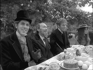 The Mad Hatter (Peter Cook), the Dormouse (Wilfred Brambell), the March Hare (Michael Gough) and Alice (Anne-Marie Mallik).