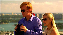 Horatio Crane (David Caruso) and Calleigh Duquesne (Emily Proctor)