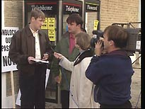 Gary (Nicholas Lyndhurst) and Ron (Victor McGuire) are interviewed by a TV reporter (Suzy Aitchison)