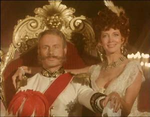 "The King of Bohemia (Wolf Kahler) and Irene Adler (Gayle Hunnicutt) pose for the fateful photograph, in ""A Scandal In Bohemia""."