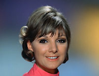 Anneke Wills as Evelyn McLean.