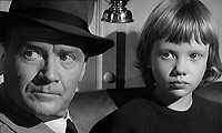 Superintendent Graham (John Mills) and Gillie (Hayley Mills).