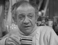 "Sid James as Sid Turner in the first season of ""Two in Clover"""